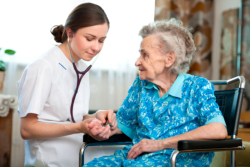 Nurse taking care of an elderly person